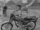 young-chinese-girl-doing-motorcycle-stunts